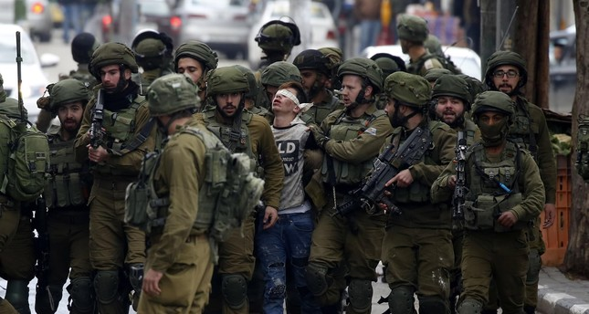 645x344-blindfolded-and-badly-beaten-16-year-old-palestinian-boy-becomes-symbol-of-jerusalem-protests-1512993862876