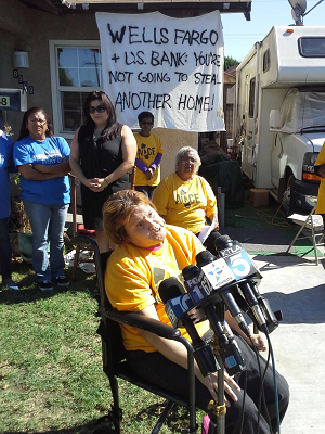 Acce-ana_casas-south_gate-speaking_on_lawn-300x400