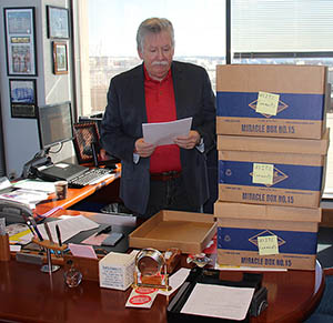 CWA President Chris Shelton with the thousands of CWA member comments to the U.S. International Trade Commission.