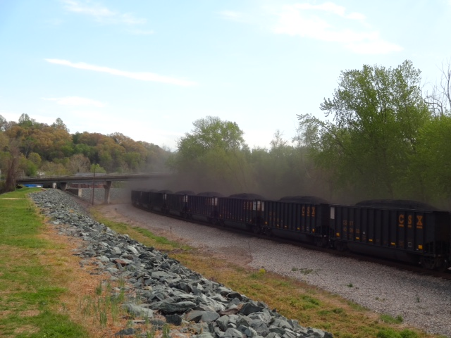 Dust flying off coal train along the James River.