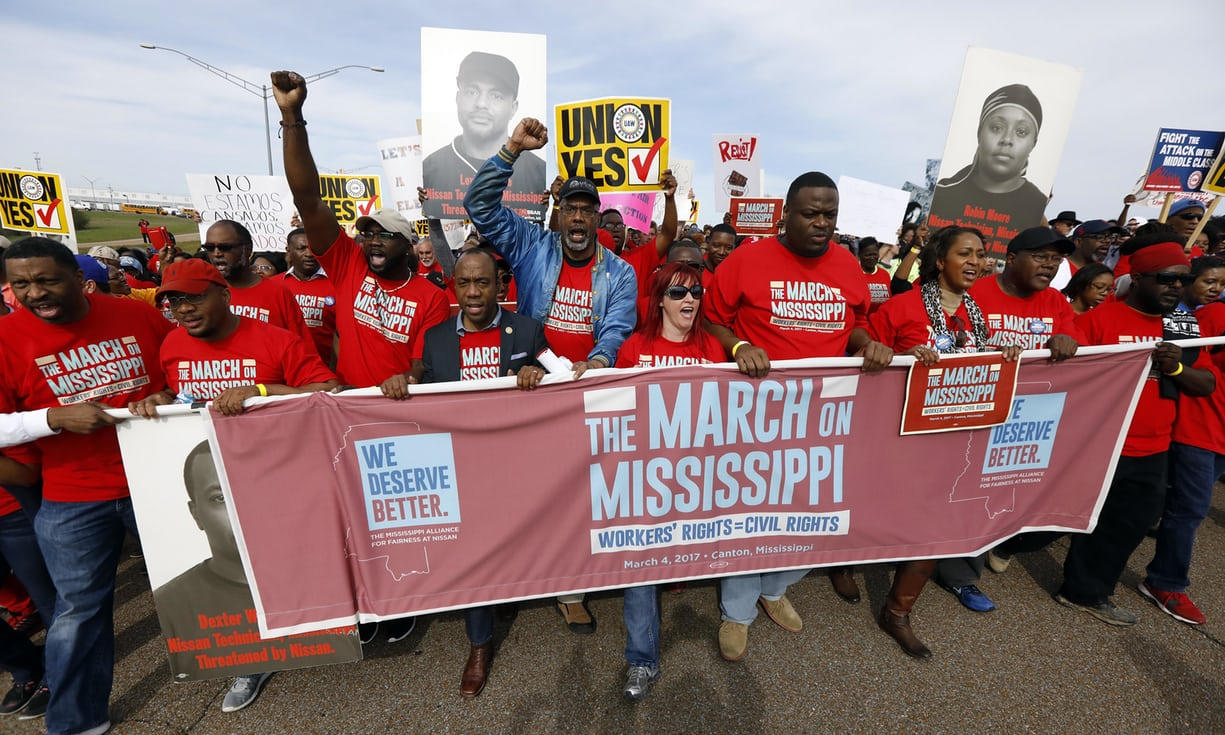 Auto workers and others march to Nissan's Canton, Mississippi, plant following a pro-union rally in March. Photograph: Rogelio V Solis/AP