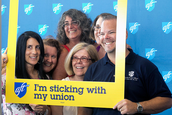 Photo of convention participants at photo booth