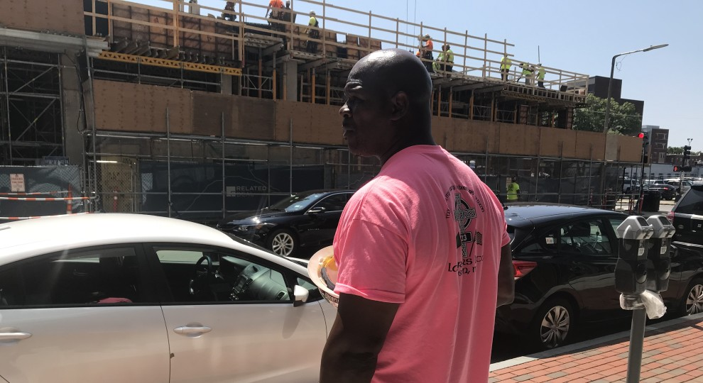 Darius Hines stands in front of a construction site on Harrison Avenue where he's a labor steward for Local 223.