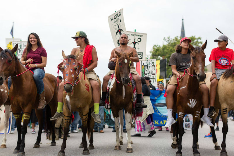 """Indigenous Youth on Horseback Lead """"March to Give KXL the Boot,"""" Lincoln, NE 2017 (Photo: Alex Matzke)"""