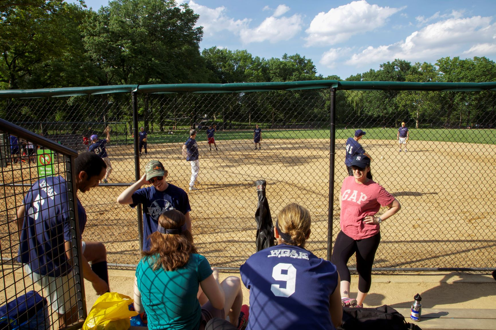 A photo of the past years' WGA East softball team at a game.