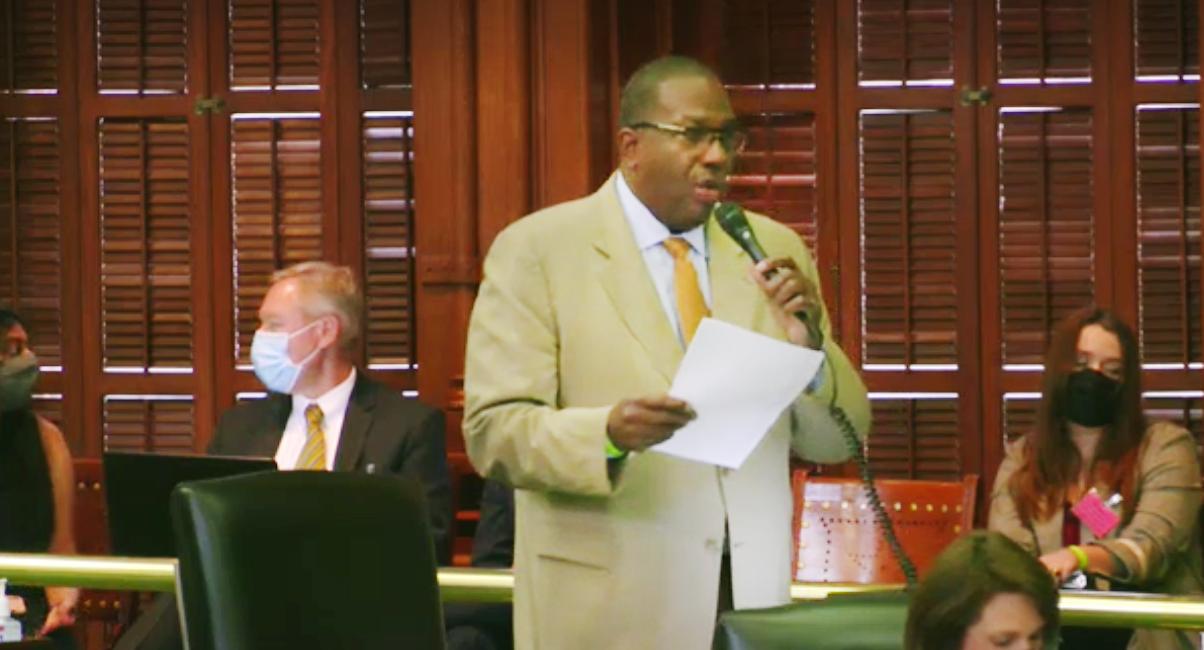 Senator Royce West with microphone speaking in Senate Chamber