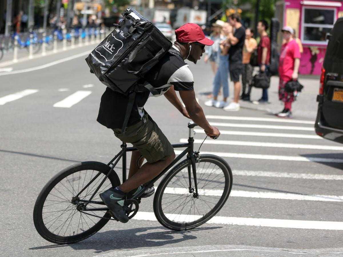 Food delivery worker biking